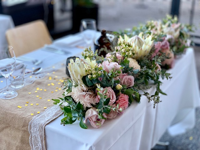 Repurposed wedding reception flowers