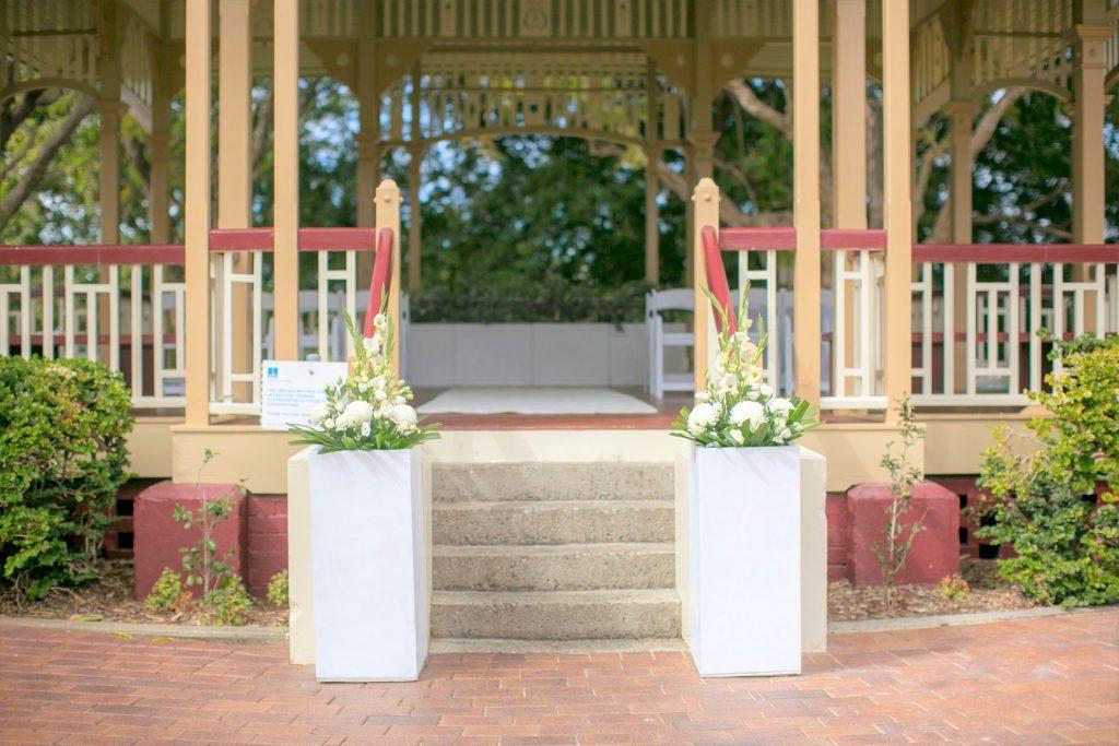 Wedding aisle pillar flowers New Farm Rotunda