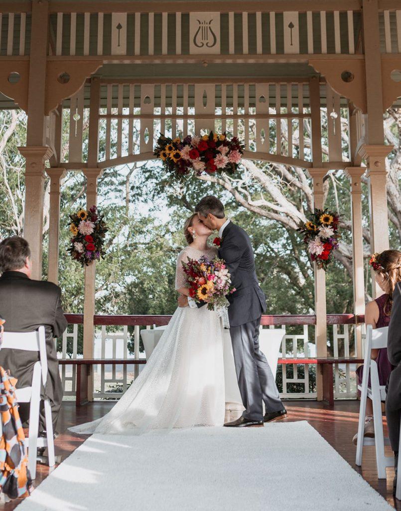 Colourful wedding ceremony flowers