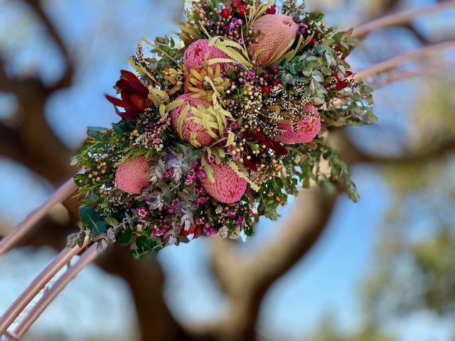 circular rose gold wedding arch flowers Brisbane