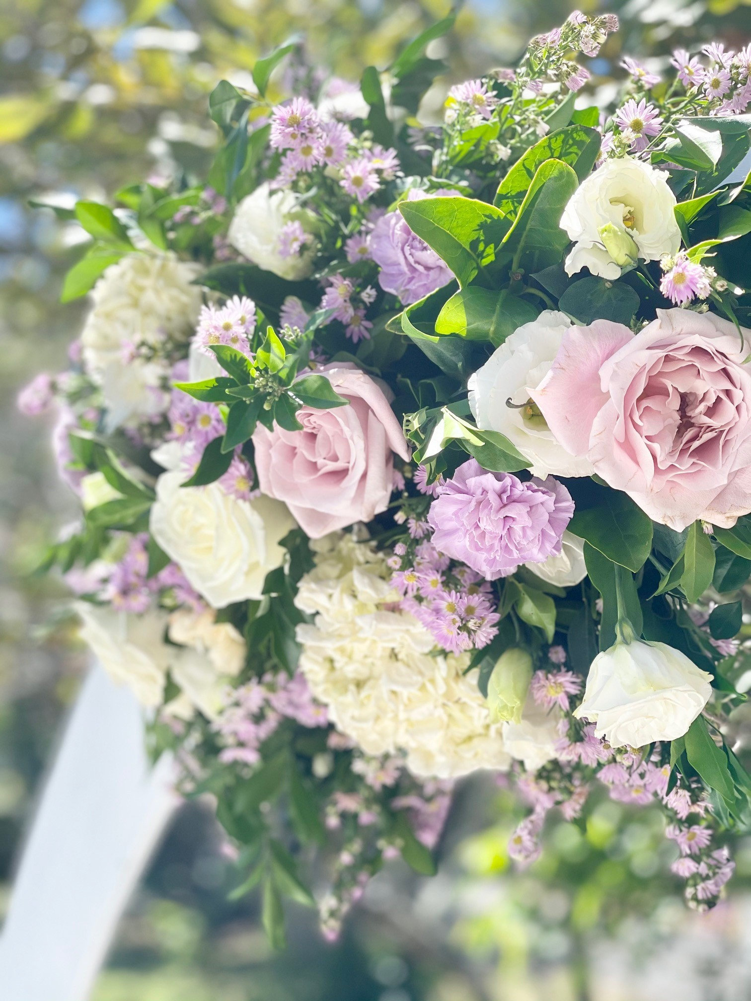 Lilac wedding arch flowers
