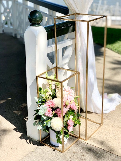 gold plinths wedding ceremony set up
